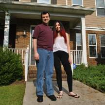 2021 photo of Dr. Britt and me in front of our house